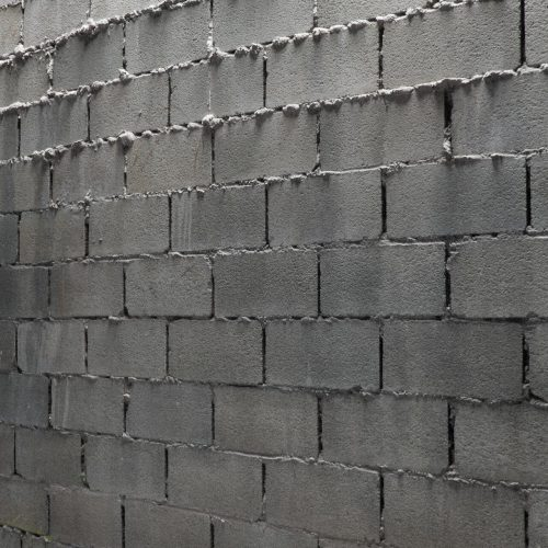 The image shows a render of a wall made using the sloppy blocks texture